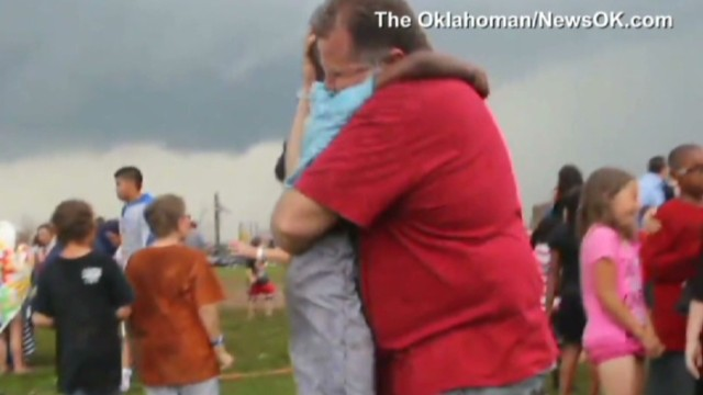 Boy, neighbor embrace after tornado