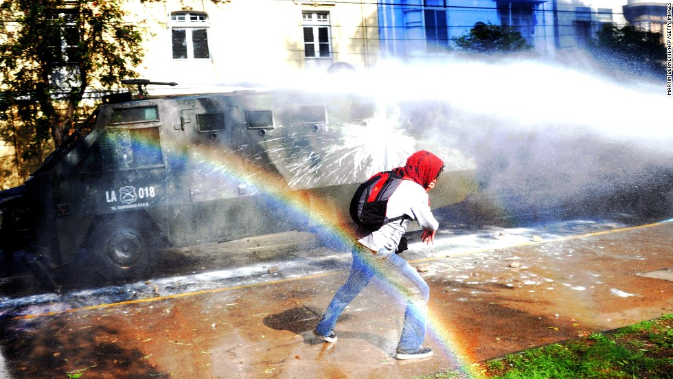 MAY 22 - VALPARAISO, CHILE: Demonstrators are dispersed by police water cannons during clashes in Valparaiso. Students in Chile have been demanding a fairer education system which would allow those from poorer backgrounds access to the best schools.