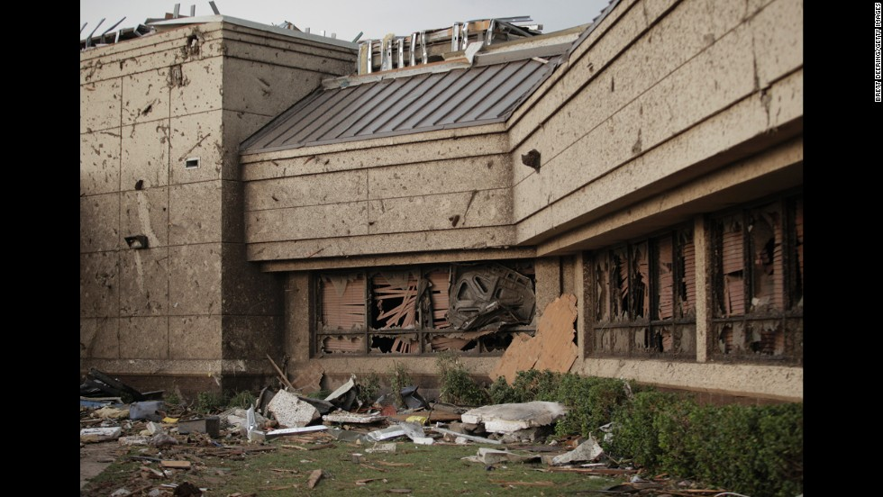 The hood of a car is wedged into the front window of Moore Medical Center on May 20.