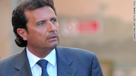 Costa Concordia captain Francesco Schettino leaves after a session of the trial in the Costa Concordia cruise ship disaster on April 15, 2013 in Grossetto. The deadly Costa Concordia cruise ship disaster returns to court in Italy today with the start of a long series of indictment hearings against six suspects including captain Francesco Schettino. AFP PHOTO / TIZIANA FABI (Photo credit should read TIZIANA FABI,TIZIANA FABI/AFP/Getty Images)