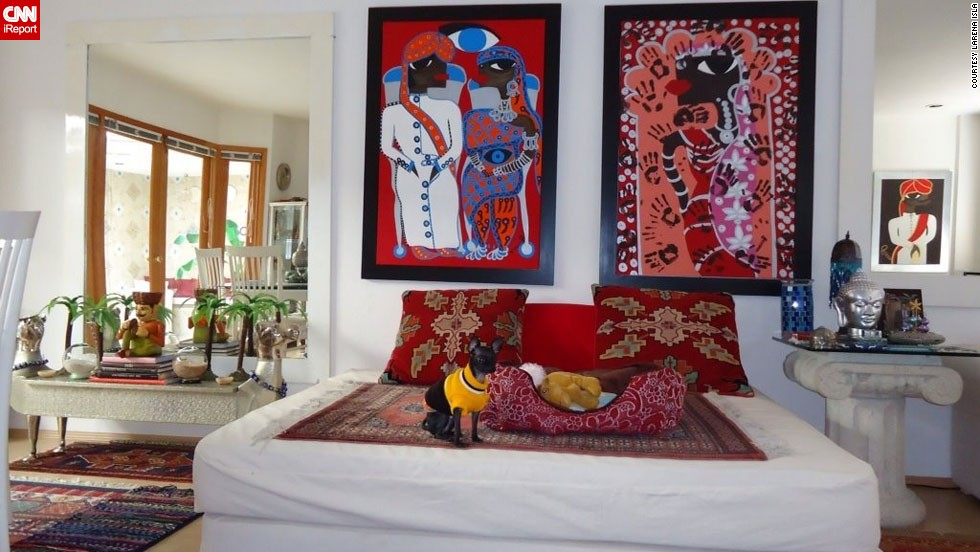 "<a href=""http://ireport.cnn.com/docs/DOC-944252"">Larena Isla</a>, a painter in Mexico City, brought back memories of India, Nepal and Dubai in her dining room. She placed a bed on the floor in the room and surrounded it with her paintings, inspired by the time she spent in India."