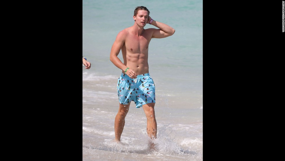 Patrick Schwarzenegger (son of Arnold and Maria Shriver) joined some friends in having a blast on the beach while on vacation in Miami in March 2013.