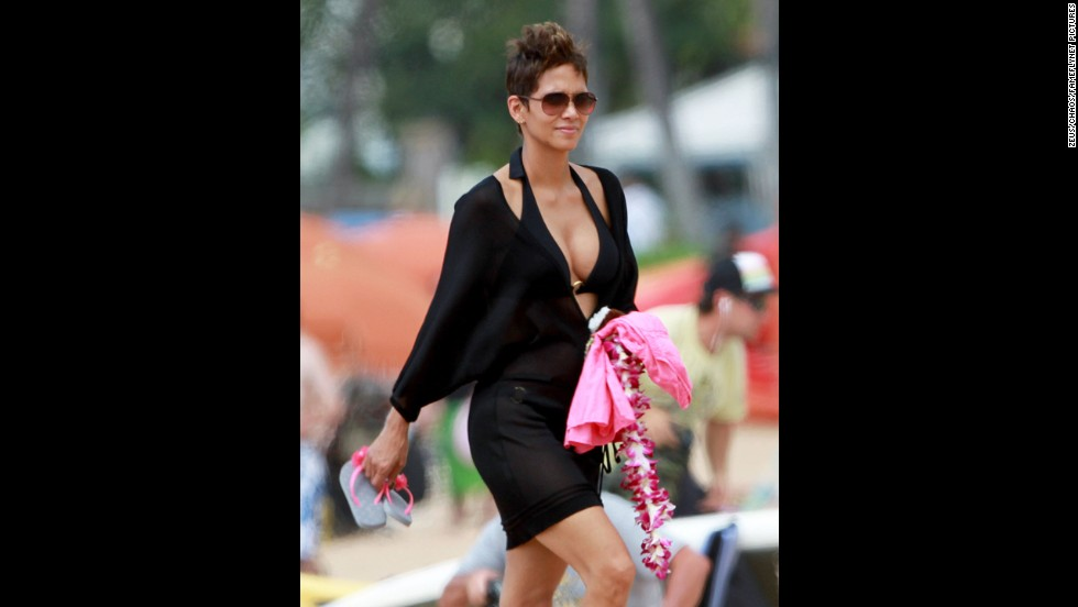 Mommy-to-be again Halle Berry headed to the beach in Hawaii with her fiance, Olivier Martinez, and her daughter, Nahla, in March 2013.