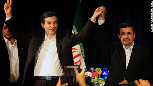 Iranian President Mahmoud Ahmadinejad (R) and Esfandyar Rahim Mashaie (L) wave during their press conference after Mashaie registered his candidacy for the upcoming presidential election at the interior ministry in Tehran on May 11, 2013. Iran is expected to wrap up the five-day registration of candidates on May 13, leaving the fate of the hopefuls in the hands of the Guardians Council, an unelected body controlled by religious conservatives appointed by Khamenei. AFP PHOTO/BEHROUZ MEHRI (Photo credit should read BEHROUZ MEHRI/AFP/Getty Images)