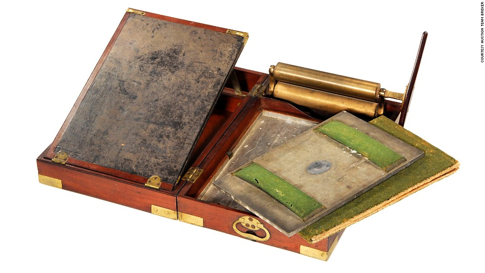 This portable copying press was devised by legendary English steam-engine inventor James Watt. The copying apparatus, consisting of metal damping box, pressure plate and special moistened copying paper, was housed in an elegant brass-bound mahogany box.