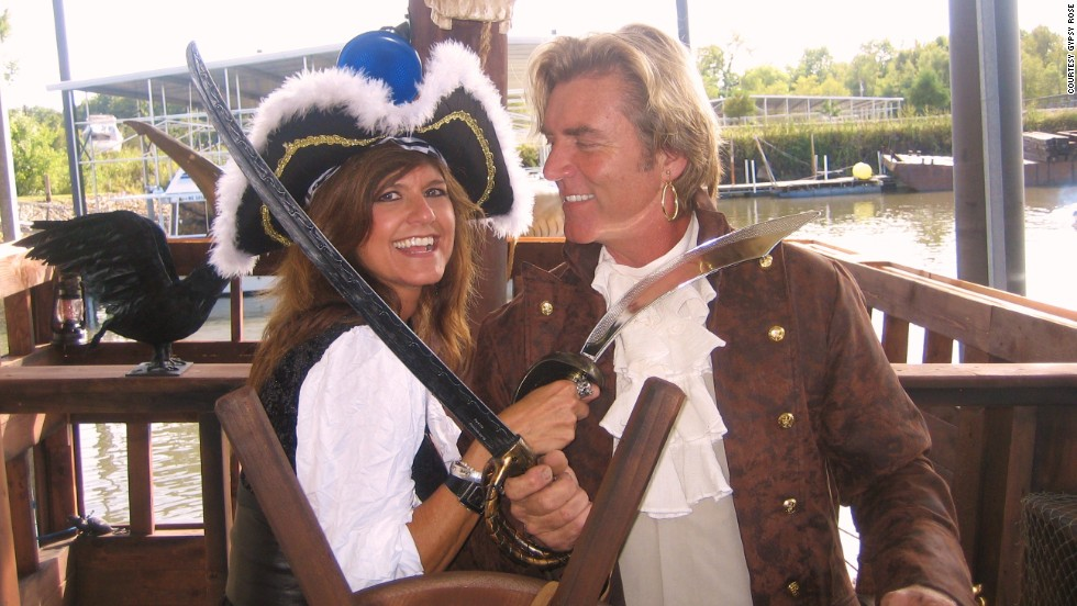 "The Gypsy Rose II is one of six pirate ships built by Woodson (pictured with girlfriend ""Wench Maria""), and sailed along the Mississippi River as part of sightseeing cruises."