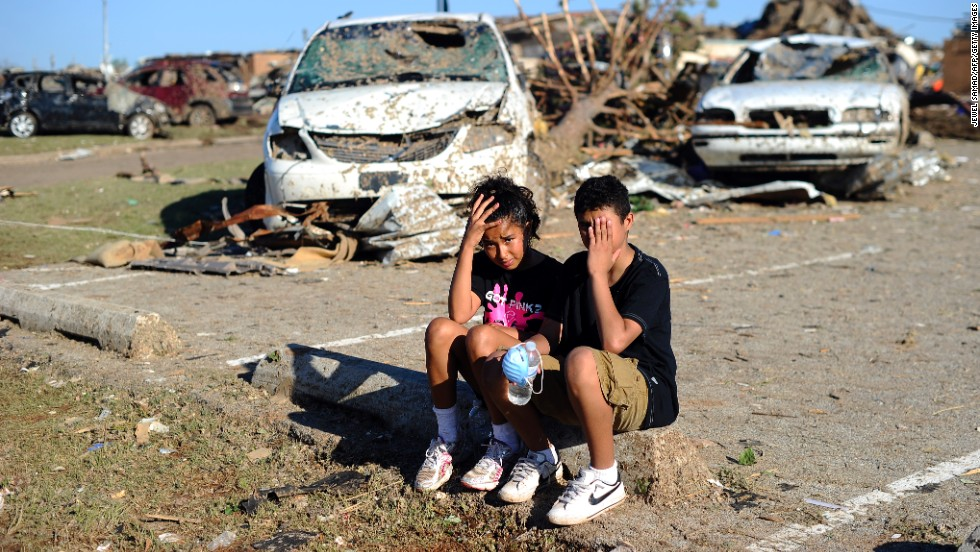 Plaza Towers Elementary School students Monica Boyd and Lavontey Rodriguez sit at the parking lot of their tornado devastated school.