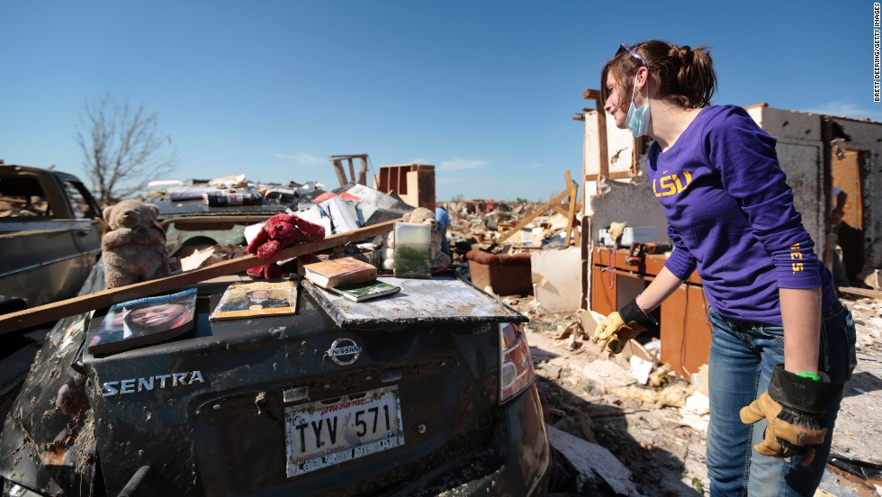 Tara McDonald shows some items salvaged from her home on May 22.