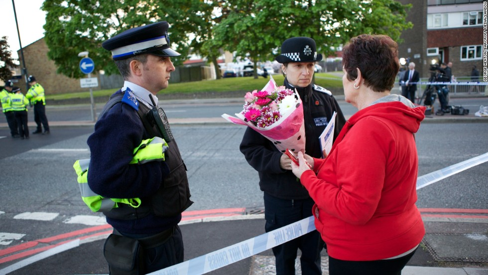 Mary Warder brings flowers to the scene of the crime on May 22 to pay respects to the victim.