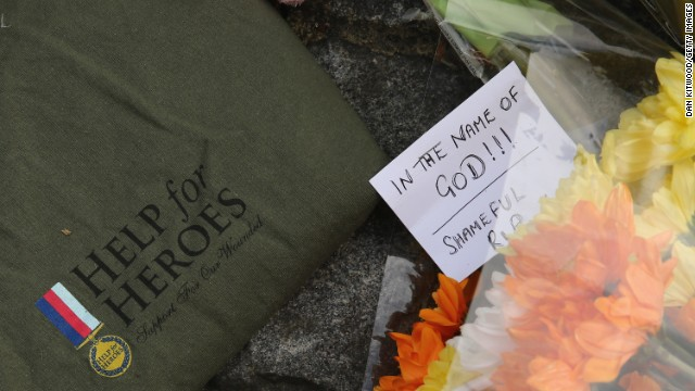 Flowers lay outside Woolwich Barracks in London, near where a British soldier was butchered in the street.