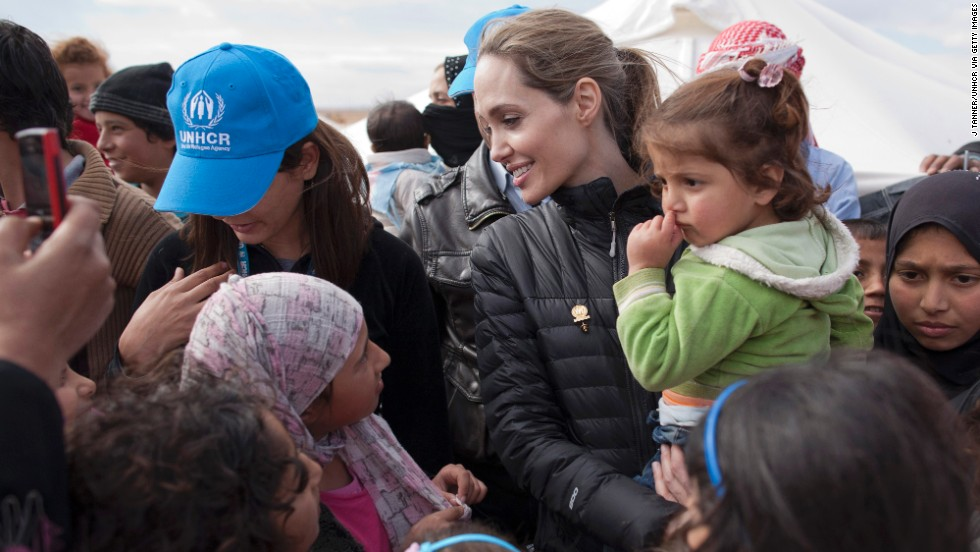 Jolie meets with refugees at the Zaatari refugee camp outside of Mafraq, Jordan, on December 6, 2012, in this handout image provided by the United Nations High Commissioner for Refugees.