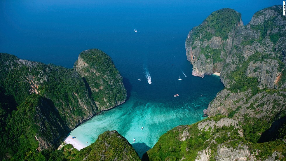 Consider something spectacular for your next beach vacation. Ko Phi Phi in southern Thailand's Krabi province is an archipelago of six islands about an hour's boat ride from Phuket. On Phi Phi Leh, towering limestone cliffs surround Maya Bay's pristine beach.