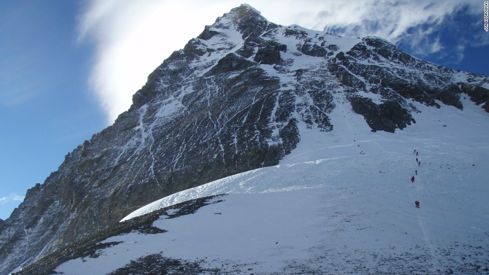 Jon Kedrowski snapped this photo at 6:30 p.m. on May 19th, 2012, at 26,000 feet as he looked out from his tent. He thought the climbers were beginning their summit attempt, but many clustered at the top were just beginning to come down from the top.