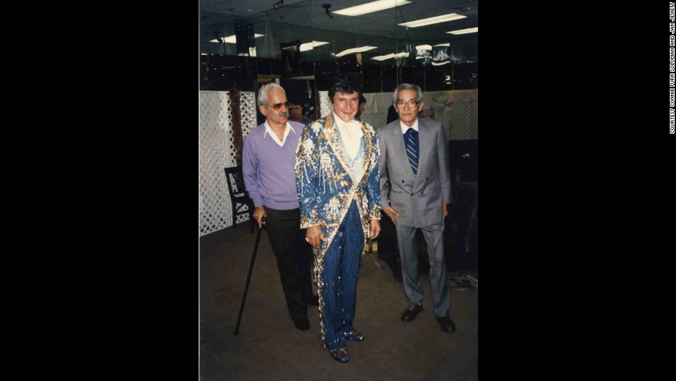 Here, Liberace is seen with Michael Travis and Primo.