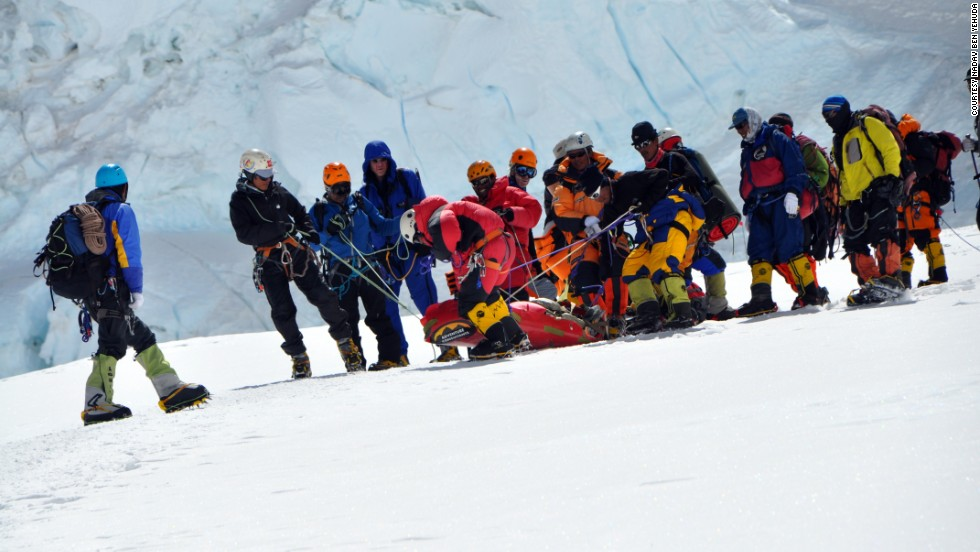 Climbers on Everest work to help someone in distress.