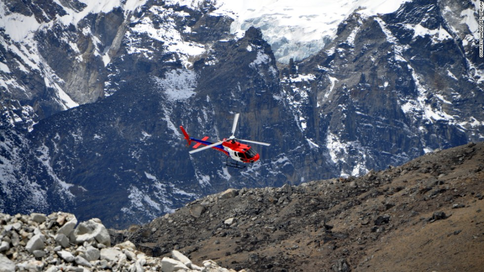 A helicopter flies into base camp. Rescue helicopters can't fly above Camp 2 on Everest to reach stranded climbers.