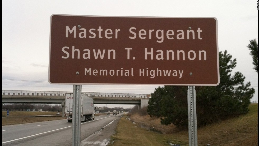 A highway sign on Interstate 71 in Grove City, Ohio, which runs near Army Master Sgt. Shawn T. Hannon's hometown. He is one of some 70 fallen soldiers memorialized in road signs along Ohio's highways.