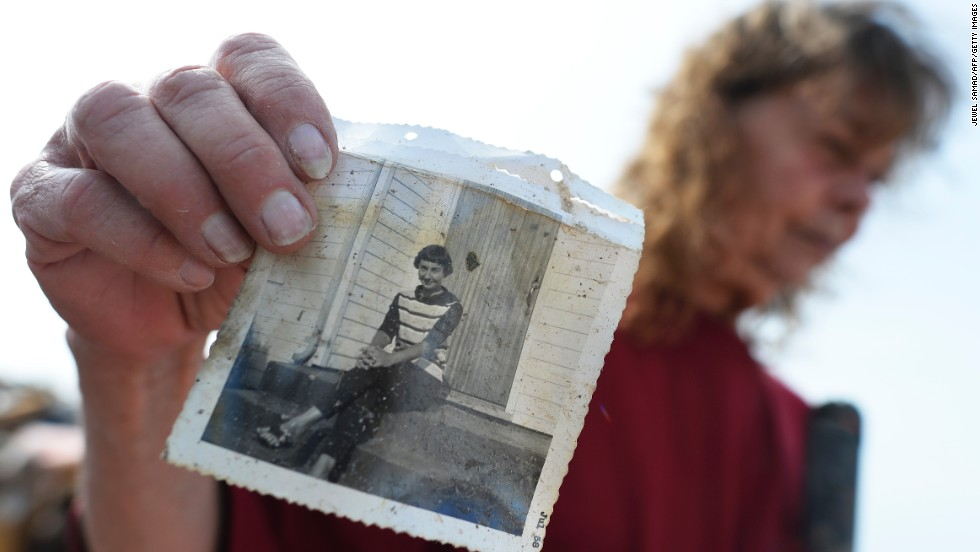 Carol Kawaykla holds a picture of her mother she found in the rubble of her tornado-devastated home in Moore, Oklahoma, on May 24.