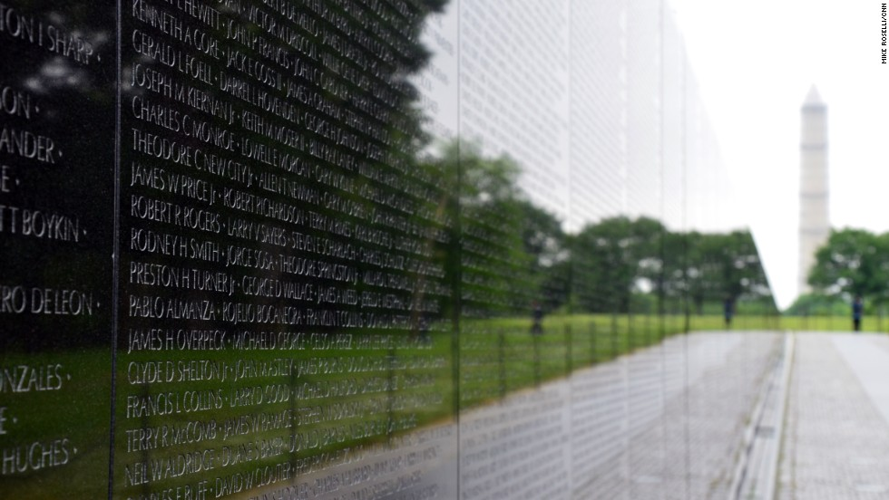 The black granite wall of the Vietnam Veterans Memorial is etched with the names of more than 58,000 Americans who died in that conflict.