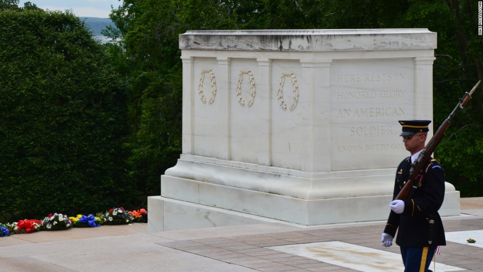 A solitary soldier guards the Tomb of the Unknowns at Arlington National Cemetery. President Barack Obama will participate in a wreath-laying ceremony there on Monday.