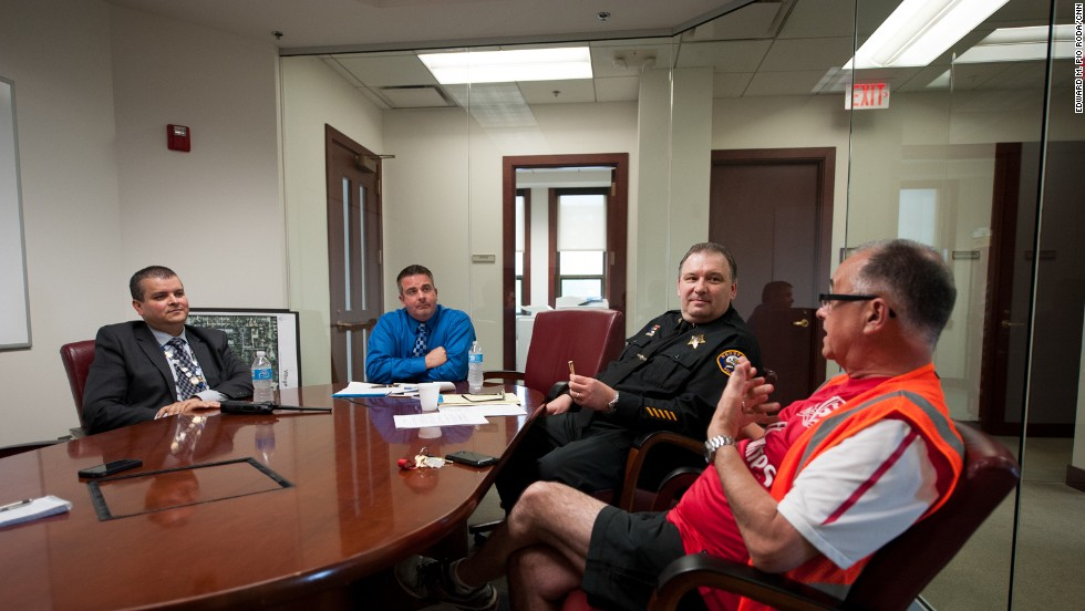 Bensenville Police Officer Joel Vargas, from left, Bensenville Village President Frank Soto and Police Deputy Chief John Lustro meet with ORD Airport Watch board member Steve Bailey. Along with local police, the spotters also meet regularly with airport authorities and officials with the TSA and FBI.