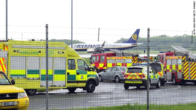 Emergency vehicles are pictured in Stansted Airport on May 24, 2013, shortly after a Pakistani International Airlines (PIA) plane landed at the airport after fighter jets were scrambled to investigate an incident on board. Police said the men were detained on suspicion of endangering an aircraft after the plane, which was carrying 300 passengers from the Pakistani city of Lahore to Manchester in northwest England, was diverted to Stansted airport outside London