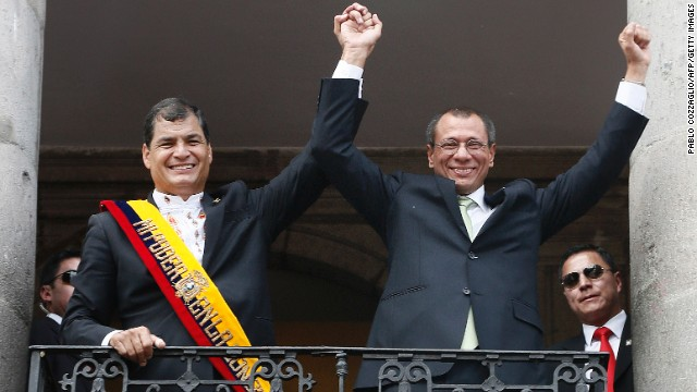 Ecuadorean President Rafael Correa (L) and Vicepresident Jorge Glass wave from a Carondelet Presidential Palace balcony in Quito on May 24, 2013. Ecuador's hugely popular leftist president, Rafael Correa, was sworn in to a second term Friday, with energy reform and expanded overseas trade topping his agenda.