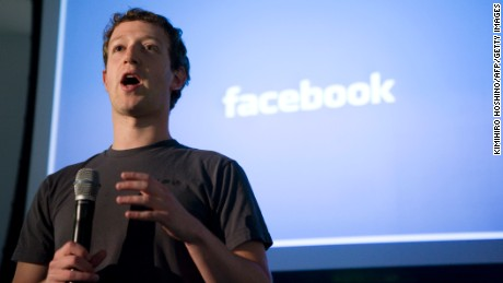 "Mark Zuckerberg, CEO of Facebook, makes an opening speech of the media event, ""behind the Scenes"" to show the latest technology powering Facebook at their headquarters in Palo Alto on April 7, 2011 in California. AFP Photo Kimihiro Hoshino (Photo credit should read KIMIHIRO HOSHINO/AFP/Getty Images)"
