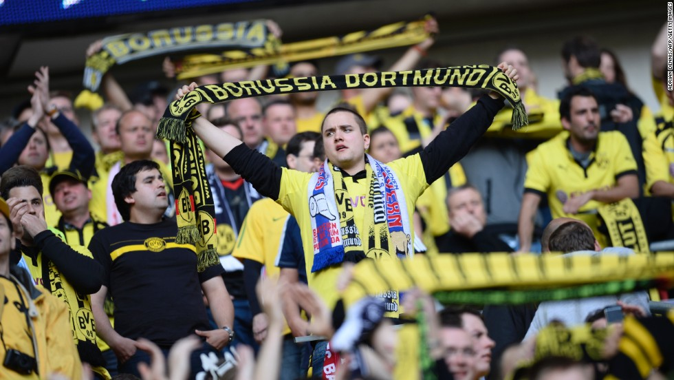 Borussia Dortmund supporters fill the stands as they wait for their team to take the field.