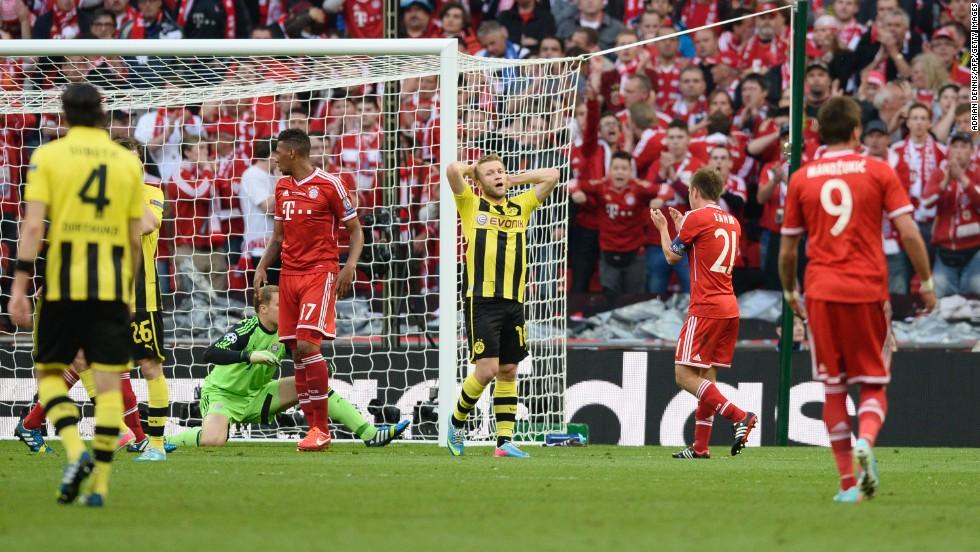 Borussia Dortmund's Polish midfielder Jakub Blaszczykowski, center, reacts after missing a goal against Dortmund.