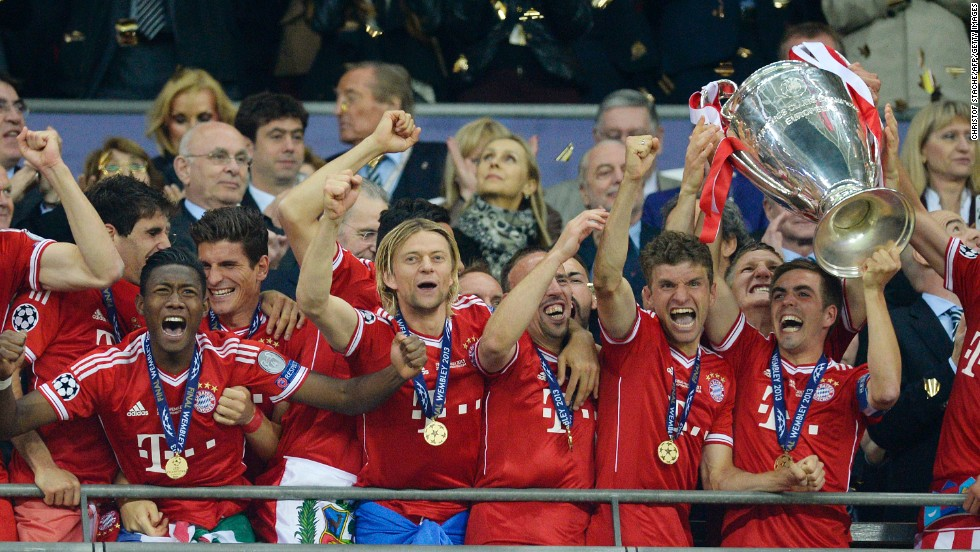 Bayern Munich players lift the trophy as they celebrate winning the UEFA Champions League final after beating Borussia Dortmund 2-1 at Wembley Stadium in London on Saturday, May 25.