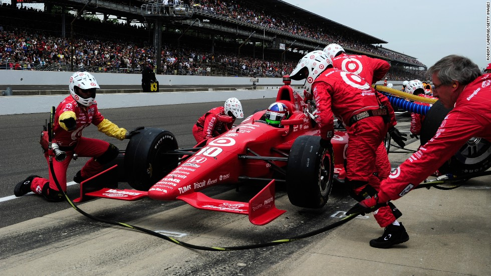 Dario Franchitti's  No.10 stops in the pit.