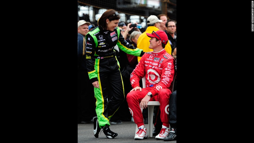 Katherine Legge of England, left, and Scott Dixon of New Zealand talk before the start of the race.