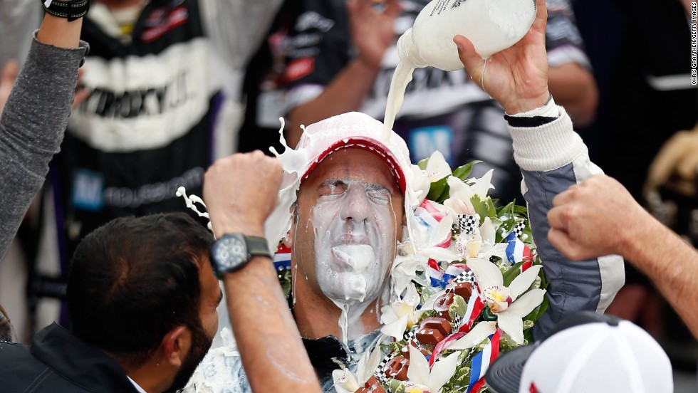 Brazil's Tony Kanaan, driver of the Hydroxycut KV Racing Technology-SH Racing Chevrolet, pours the traditional victory milk over his head after winning the Indianapolis 500 at the Indianapolis Motor Speedway on Sunday, May 26.
