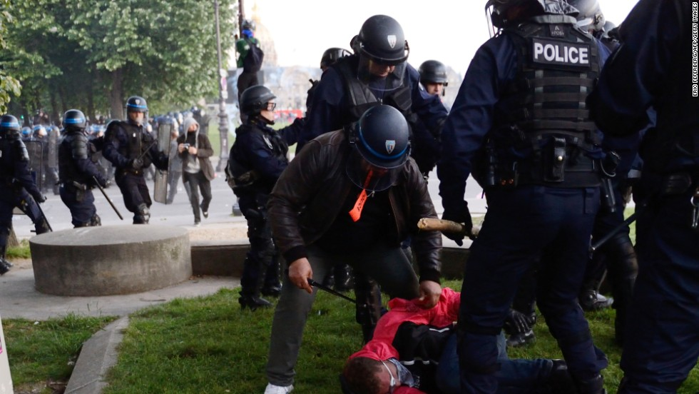 Riot police arrest a protester on May 26.
