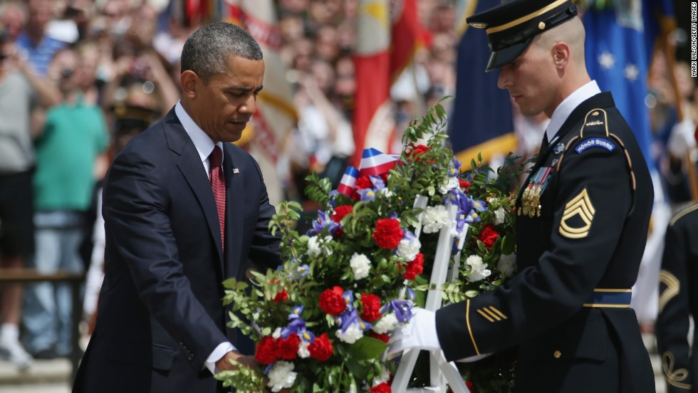 Obama lays a commemorative wreath at the Tomb of the Unknowns at Arlington National Cemetery.