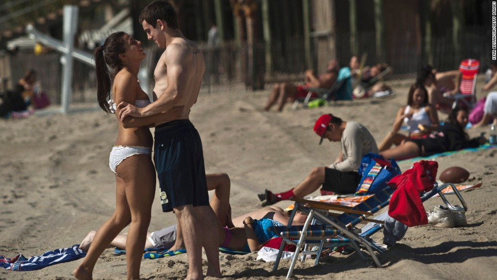 Sunbathers celebrate the Memorial Day weekend in Long Branch, New Jersey, on Monday, May 27. Jersey Shore beaches are reopening as the region recovers from Hurricane Sandy.