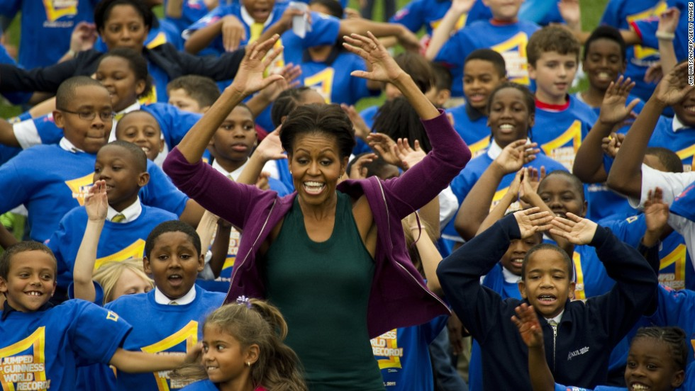 First Lady Michelle Obama is surrounded by school children as she launched a challenge to help break the Guinness World Records title for the most people doing jumping jacks in a 24-hour period. The 'Let's Move!' event took place on the White House South Lawn in Washington, DC on October 11, 2011.