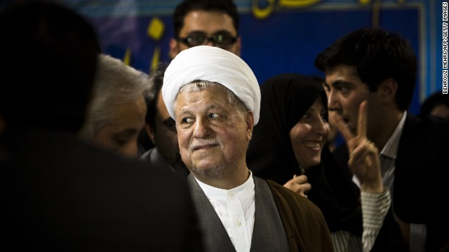 Former Iranian president Akbar Hashemi Rafsanjani (C) arrives to register his candidacy for the upcoming presidential election at the interior ministry in Tehran on May 11, 2013. Rafsanjani, who has been isolated since the 2009 presidential election which saw massive street protests against the disputed re-election of President Mahmoud Ahmadinejad, registered his candidacy to stand for office again. AFP PHOTO/BEHROUZ MEHRI (Photo credit should read BEHROUZ MEHRI/AFP/Getty Images)