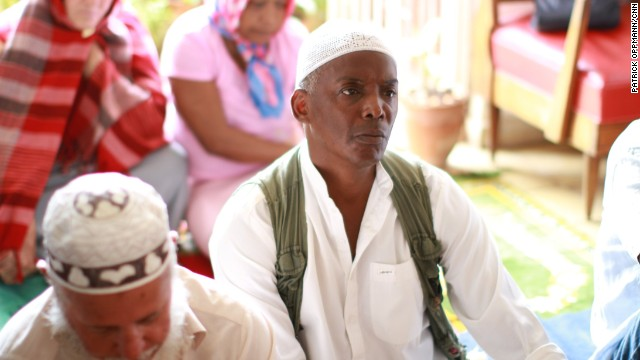 William Potts prays with other Muslims in Alamar, Cuba on May 17, 2013. After nearly 30 years of living as a fugitive on the island, Potts says he is ready to return to the U.S. and face hijacking charges.