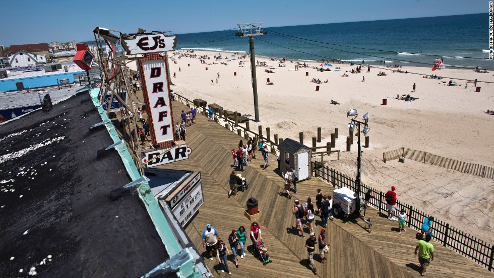 Visitors enjoy the boardwalk and beach in Seaside Heights.