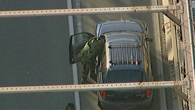 A member of the bomb squad searches the suspicious vehicle on the Brooklyn Bridge on Monday.
