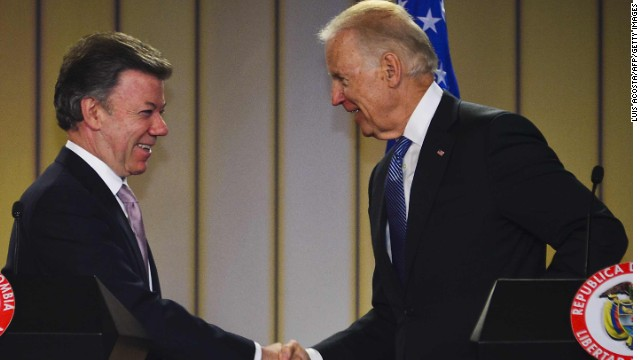 Colombian President Juan Manuel Santos (L) and US Vice-President Joe Biden shake hands after offering a joint press conference following a meeting at the Narino presidential palace in Bogota, on May 27, 2013. US Vice-President Joe Biden arrived in Colombia on Sunday as he launched a six-day tour that will also take him to the Caribbean island nation of Trinidad and Tobago, and Brazil.