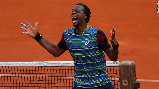 Wild card Gael Monfils celebrates his unexpected victory over fifth seed Tomas Berdych of Czech Republic.