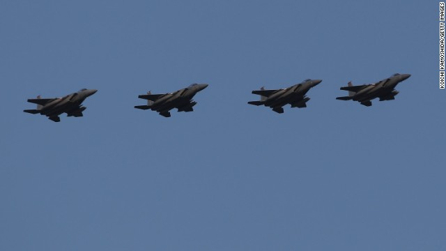 U.S. Air Force F-15 fighter jets fly over Kadena Air Base on February 25, 2010.