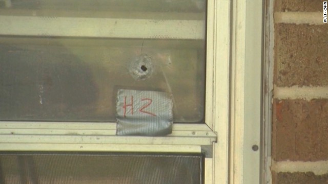 A bullet hole is left in a window after a shooting spree in Texas.
