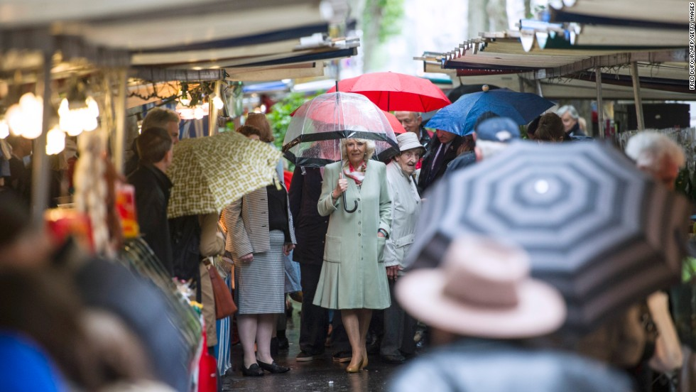 "Camilla strolls through the Parisian market. At another stall, she bought five dresses for her grand-daughters from a trader who described the duchess as polite and said she ""loved everything."""