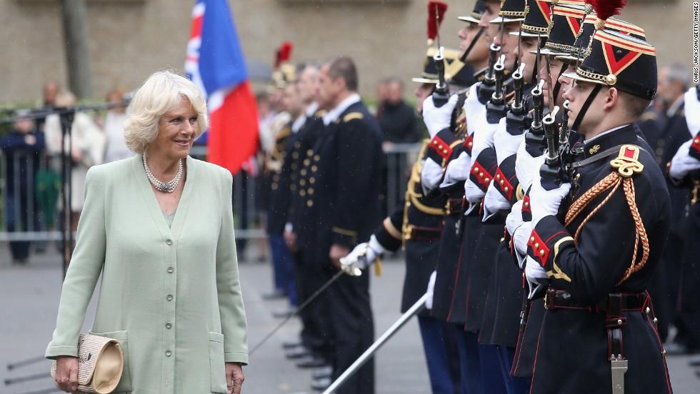 Camilla inspects an honor guard at la Garde républicaine headquarters.