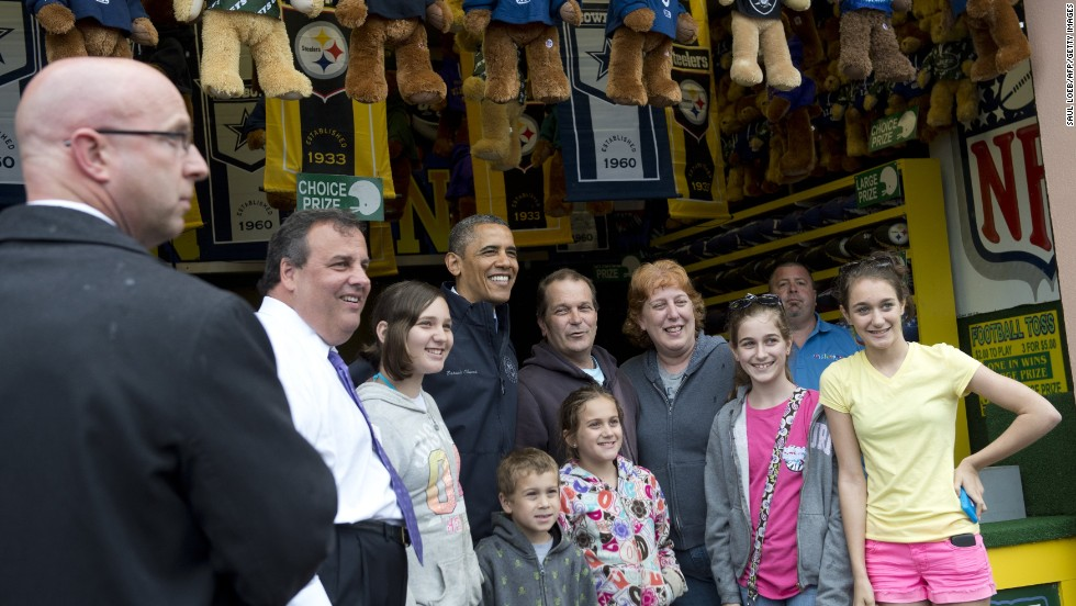 Obama and Christie pose for photos along the boardwalk in Point Pleasant as they view rebuilding efforts.