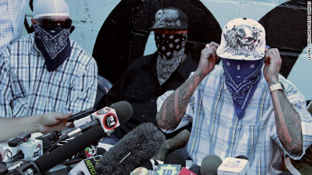 Members of the Mara Salvatrucha (MS-13) gang, offer a press conference at a prison in San Pedro Sula, 240 km north of Tegucigalpa, on May 28, 2013. Leaders of the MS-13 and the Mara 18 (M-18) of Honduras, announced their disposition to reach a truce with the mediation of the Organization of American States (OAS) and the Catholic Church. The gangs are involved in drug trafficking that has brought terror to El Salvador, Guatemala and Honduras.